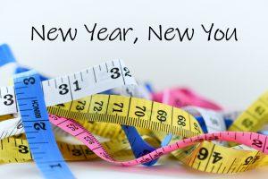 """Metru pentru măsurarea taliei însoțit de mesajul """"Un nou an, o nouă versiune a ta"""""""