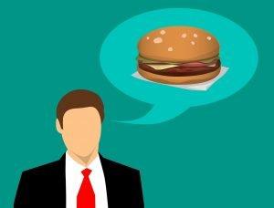 Ilustrație în care un bărbat se gândește la mâncare